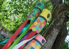 Beautiful Japanese carp kites.  (I think I would cut an oval out of the top to make more of a mouth....)