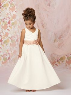 Sweet Beginnings Style #L287: Shown in Diamond White/Ice Pink…Satin dress with a mock wrap bodice with contrasting waistband and flowers. Full skirt with pleats at waist. Available in ankle or floor length. Available in any combination of two colors. Perfect for any little flower girl!      Available in sizes 1-14 & 5+ - 9+   http://www.jordanfashions.com/collections/sweet-beginnings