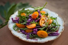 A simple, colorful salad: argula, yellow cherry tomatoes.