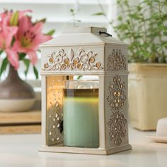 The Fluer De Lis is the perfect Candle Warmer to fancy up any room with fragrance and decor!