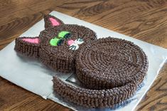 Two round cakes and few cuts give you an adorable cat cut-up cake. Easy enough for kids, and perfect for making a black cat for Halloween!
