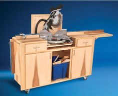Mobile Miter Saw Stand - The Woodworker's Shop - American Woodworker  I like that this version isn't so long and would fit in a more compact space yet still able to handle larger pieces with the wing extensions on the ends.