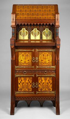 Walnut, maple, white pine, and glass Modern Gothic cabinet, design attributed to Frank Furness; manufactured by Daniel Pabst; Philadelphia, ca. 1874–77