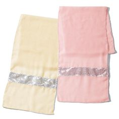 """Two sparkling 18"""" W x 72"""" L scarves (one in pink, one in ivory) bring a shower of shimmer to any outfit. Polyester. Hand wash, dry flat. Imported."""