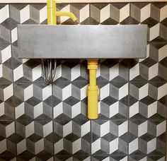 Duchamp encaustic tiles from Bert and May work harmoniously with their mini concrete basin