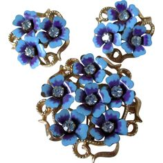 Lovely blue enamel with purple accents and centers of blue rhinestones all clustered together make this Avon set from 1972 -- found at www.rubylane.com @rubylanecom #VintageBeginsHere #MondayBlues