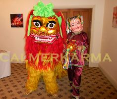 CHINESE LION with traditional herder having fun with the guests as they arrive at this prestigious Chinese New Year Event in Bristol. Tel: 020 3602 9540  UK ENTERTAINMENT AGENCY spreading Chinese Lion Dance luck for everyone across MANCHESTER, STAFFORDSHIRE, BIRMINGHAM, BRISTOL, BRIGHTON & LONDON  Tel:  020 3602 9540 http://www.calmerkarma.org.uk/Chinese-Themed-party-entertainment.htm