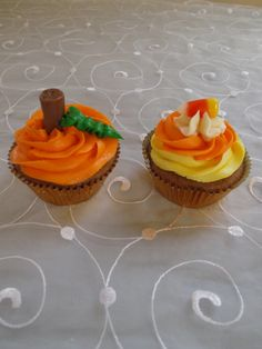 Halloween Cupcakes! They are decorated with Tootsie Rolls for the pumpkin stems and candy corn