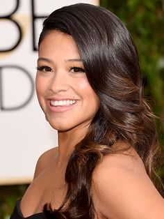 BOLD LASHES Full lashes like Gina Rodriguez's basically do the flirting for you. To get her bat-able lashes, draw a cat eye on the top lid with an inky liquid liner, such as Benefit Magic Ink Jet-Black Liquid Eyeliner. Then curl your real lashes before applying a few individual fake ones (full strips can look too showgirl) near the outer corner. A coat of regular mascara will blend everything together. If you'd prefer to skip the falsies, an extra-plumping formula can mimic the effect.