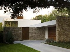 Glenwood Residence in Texas by Wernerfield Architects- key features- stacked stone, smooth stucco, vertical/horizontal wood