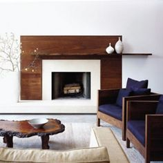 Love this modern/earthy look for the fireplace. possibility in family room? A modern fireplace instantly become a breathtaking focal point for any room, but with new advances in energy efficiency. See the best designs about fireplace ideas Wood Fireplace Surrounds, Fireplace Wall, Living Room With Fireplace, Fireplace Design, White Fireplace, Fireplace Ideas, Basement Fireplace, Fireplace Facade, Fireplace Drawing