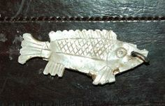 Mother of pearl fish pendant excavated at Jamestown.