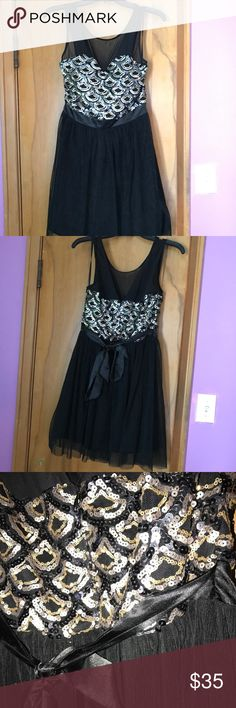 Homecoming dress A beautiful black dress with gold and silver details! Only worn one time and looks amazing in pictures!! Size 9 and made of nylon. As U Wish Dresses Prom