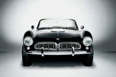 1956 BMW 507, my kind of car....I would wear a red scarf, cat-eye sunglasses with a leopard print coat and bright red lipstick while driving.