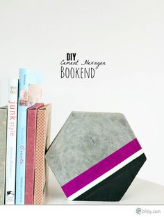 Found it at Blitsy - DIY Cement Hexagon Bookends