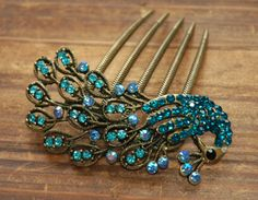 Vintage, Romantic, elegant and charming.   Detailed with soft sprinkled sparkling rhinestones all over peacocks and it's feathers.  It glitters beautifully on the hair, a fitting piece for a...