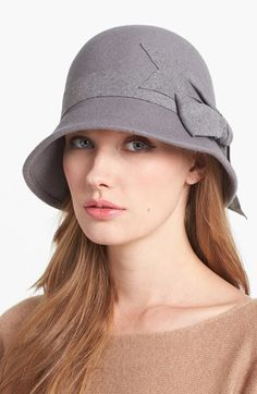 Winter is a good season for hats! Here's a classic one from Nordstrom: wool/felt cloche hat with a large bow for $42. It comes in many colors, but I'm partial to the grey.