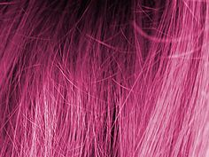 strands of dyed pink hair