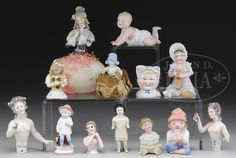 LOT OF 13 HALF DOLLS AND BISQUE FIGURINES.