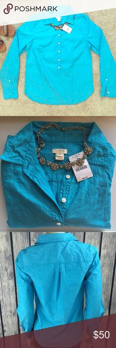 NWT J Crew Factory Button Down Blue Popover New with tags // originally purchased for $64.50 // 100% cotton // first three photos are of actual shirt // last photo for styling purposes // fits XS-S // 20% off bundles of 3 items or more J. Crew Tops Button Down Shirts