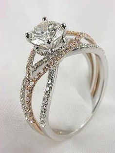 Love, but just with the solitaire diamond and a white gold band