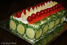 Bridal Shower Sandwich Cake.  Can use Salmon or Tuna.  Recipe is not in english, but what an amazing presentation idea for a shower.  BIG like.