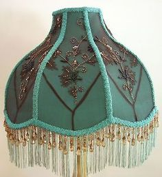 This 1920s hand wrought painted iron table lamp has accent colors this 1920s hand wrought painted iron table lamp has accent colors of violet and olive in the applied flowers on the lamp the shade is shelley sh aloadofball Choice Image