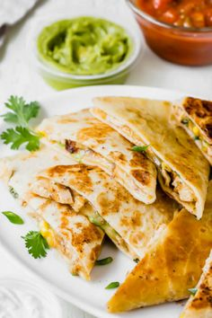 This seriously easy chicken quesadilla recipe is the perfect way to use up leftover chicken. Throw in some scallions, cilantro and corn kernels, if you have on hand, and enjoy delicious cheesy dinner in minutes! #busycooks #dinner #chicken #chickenrecipe #quesadilla #quesadillarecipe