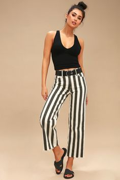 You'll be the queen of the cool girls with the PAIGE Nellie Washed Black Striped Culotte Jeans! Lightweight stretch denim, with a washed black and off-white stripe print, shapes these trendy jeans with a mid-rise waist, belt loops, and a five-pocket cut. Relaxed, culotte pant legs end in cropped, raw hems. Hidden zip fly and branded top button. Leather logo tag at back. Belt not included.