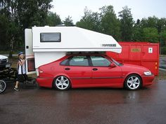 A slide-in camper for a hatchback Saab?!?! Better take out a lot of gear if you expect to drive it anywhere without destroying the tires...