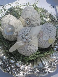 Cover plastic eggs with newspaper using modge podge then decorate with buttons, jewels, etc.: