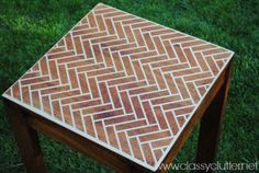 Love this. I'm thinking of doing this to a few tables from the thrift store, using different patterns to make a kick ass coffee table.