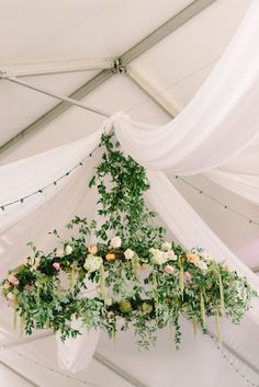Kick things up a notch by adding a serious wow factor to your wedding reception. This floral chandelier will certainly help create the garden party vibe, and will be an impressive focal point for your wedding.