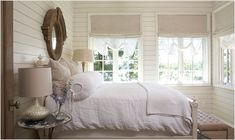 love the layered window treatments