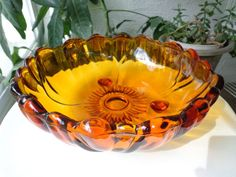 "Colony Petals Pattern Amber Colored Three Toed Footed Bowl 11""  c1970's"
