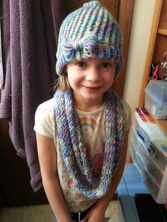 My first hat. My daughter picked her own yarn. Very cute for a little girls set.
