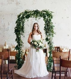 simple wedding arch with greenery and white flowers