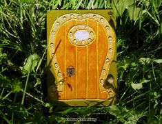 Handcrafted and hand painted unique orange & yellow Fairy door. Nice décor for home & garden. Good #gift for people of any age and for any occasion.  Every door I create by ... #handmade #pendant #botanical #creationsoftruefairy