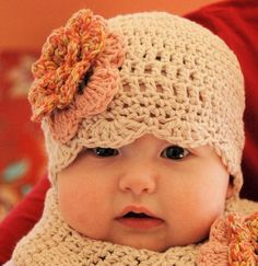 scalloped baby hat with flower pattern