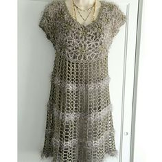 """Final Sale! Gorgeous French-Designed Layer Dress This is gorgeous, and so soft (it looks itchy, but it's not all all!). It's a taupe-gray crocheted rayon-yarn blend you can wear over a cami-dress (as pictured but not included), or over a camisole and leggings. Measurements: Bust: 17.5"""" (plus has give if needed), hips: to 21"""",  length: 35"""". MINT condition. So artsy! Final Sale, please. Price is firm. Thank you kindly. :) Dresses"""