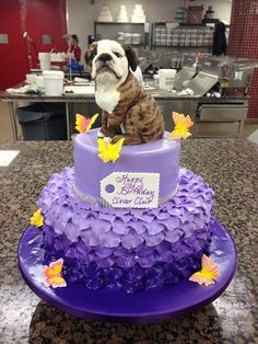 This cake is positively adorable - in every way except for the dog...  Sorry, but wrong choice for a dog.  It has got to be a yellow or black lap by all means!!!