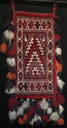 Unusually large old Turkmen igsalyk bag for carrying and storing precious drop spindles for hand spinning wool which was of such importance to nomadic cultures. In the style of spoon bags but much larger. 85x40cm including loops & tassels, bag alone 57x28cm. In very good condition, 50-60 years old.