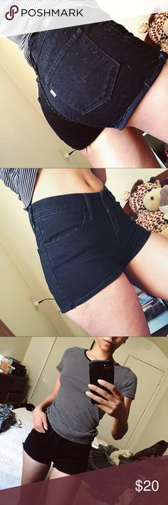 Black LEVIS Jean Cutoffs I cut these myself, you can wear them rolled up or show the distress. I had them on my bed and my bed is white (hence the lint) Levi's Shorts Jean Shorts