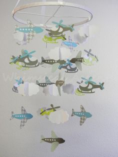 Airplane, Helicopter and Cloud Baby Paper Mobile-- you could anything that looks cool floating around as inspiration