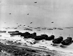 This is the scene along a section of Omaha Beach in June 1944, during Operation Overlord, the code name for the Allied invasion at the Normandy coast in France during World War II. Landing crafts put troops and supply on shore at Omaha, one of five landing beaches. Seen in the background is part of the large fleet that brought the Allied troops across the English Channel. Barrage balloons are flying in the air, designed to entangle low-flying enemy aircraft in their cables. (AP Photo)