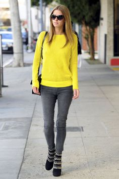 Nicky Hilton yellow sweater gray jeans