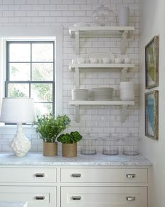 A kitchen we designed in Old Seagrove a few years back... #whiterooms #whitekitchen #shelves #subwaytile design @akporch @paigeschnell @jallsopp styling @30astyle