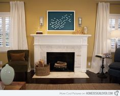 The Carrera marble surround of the fireplace bring sophisticated glam to the casual living room. Above the mantel is a playful piece of artwork featuring a school of fish.