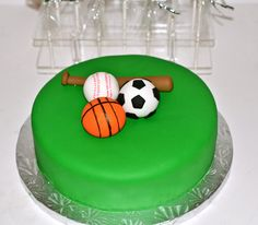 Fondant covered Sports cake with fondant soccer, baseball and basketball
