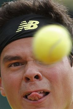 Canada's Milos Raonic eyes the ball as he returns against South Africa's Kevin Anderson in their third round match at the French Open tennis tournament, at Roland Garros stadium in Paris, Friday, May 31, 2013. (AP Photo/Christophe Ena)